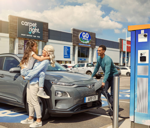 Family charging using an Osprey chargepoint at a retail park